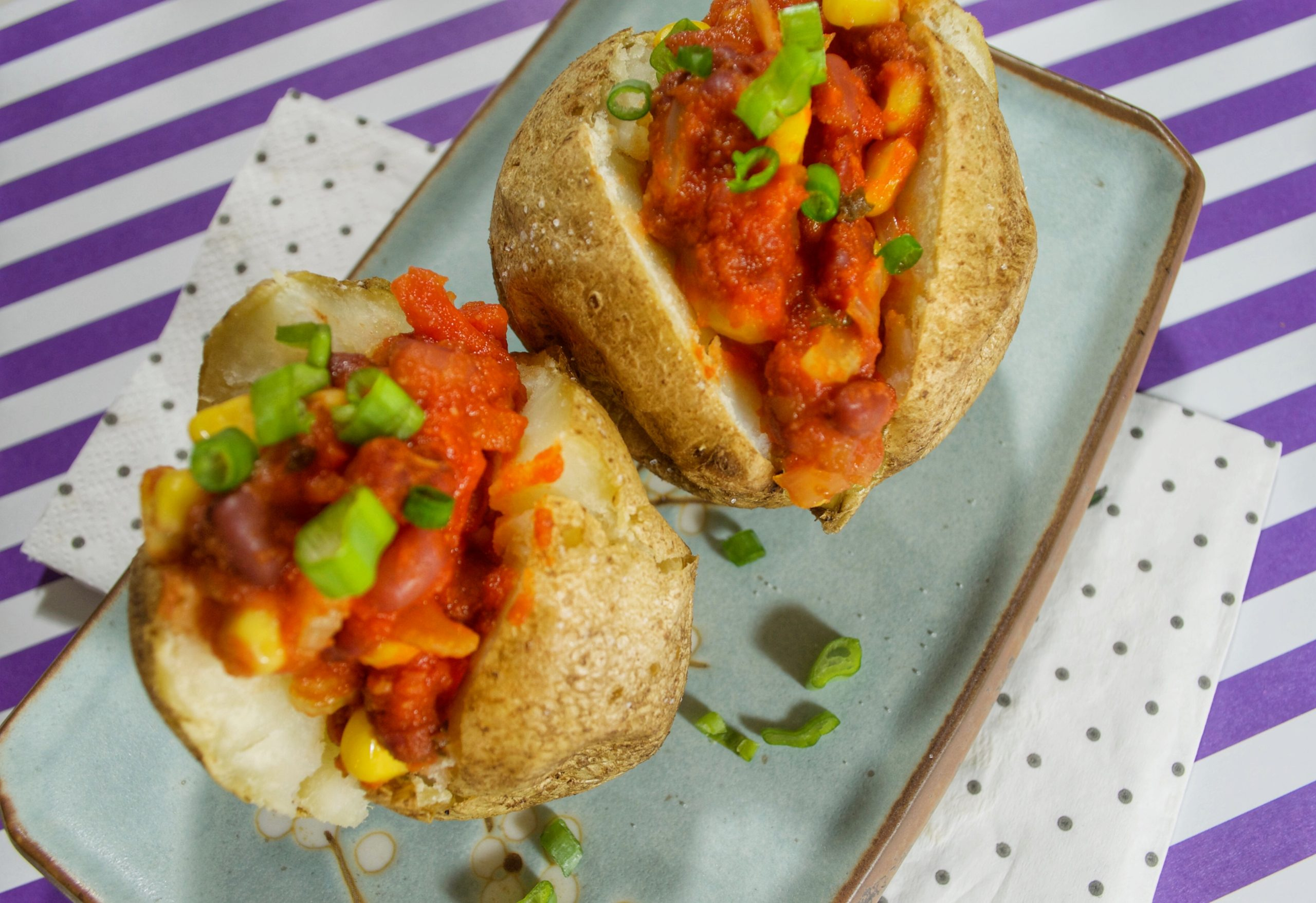 Baked potatoes loaded with vegan chilli
